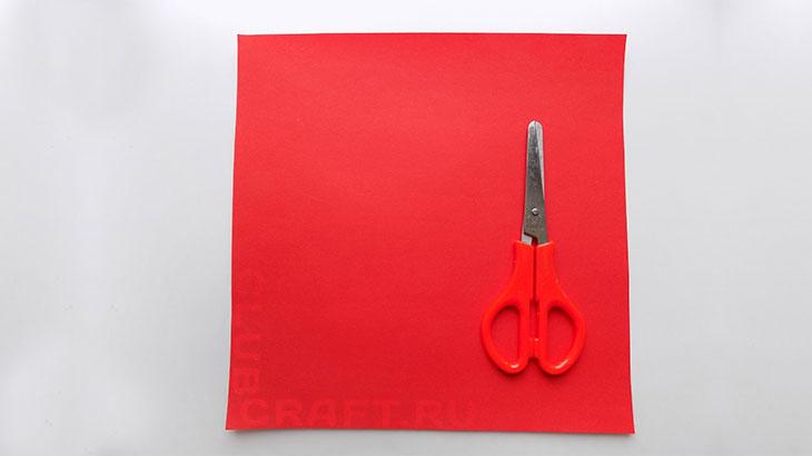 Лист бумаги и ножницы